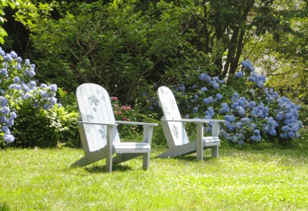 Chanticleer-blue Adirondack chairs and hydrangeas in July