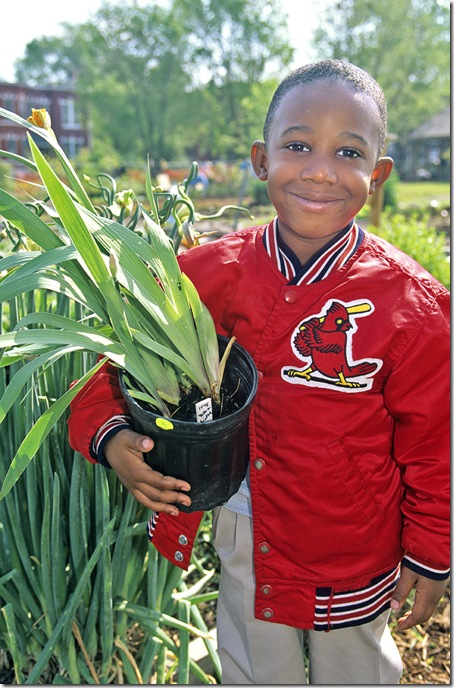 A young man clutches his newly purchased at the annual plant sale held by the Missouri Botanic Garden in St. Louis.