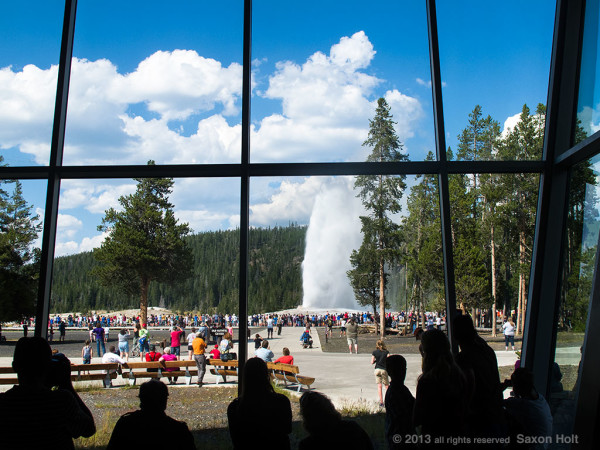 Old Faithful geyser seen from visitor center